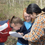 Students looking at a paper