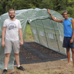 Men in front of Greenhouse